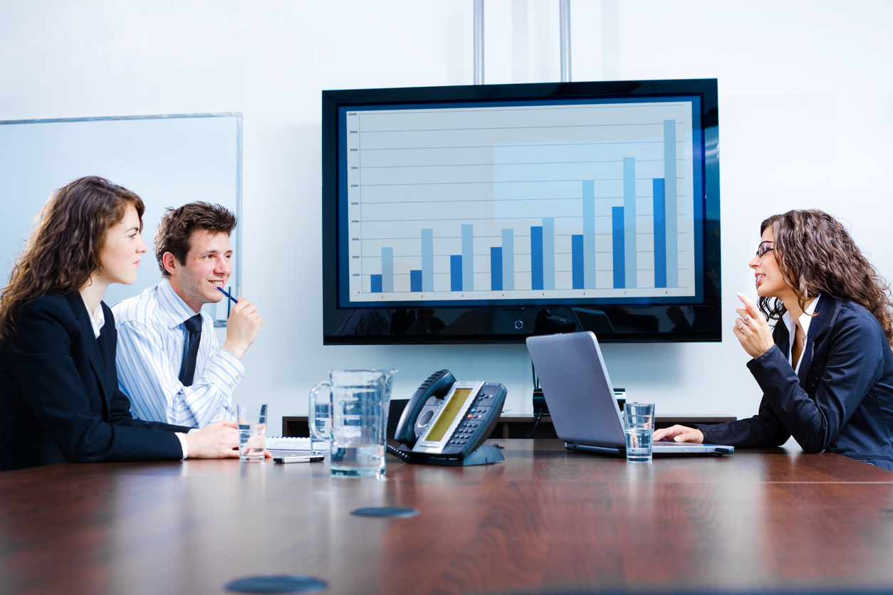 Businesspeople Discussing In Meeting Room. Click Here For Other Business Images: